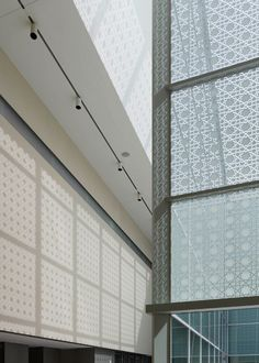 Angular walls clad with white granite and a glazed courtyard surrounded by Islamic motifs feature at Fumihiko Maki's Aga Khan Museum in Toronto.