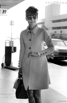 Audrey Hepburn and her LV Speedy. Classic.