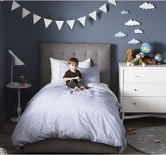 love this constellation duvet, and the dark walls and bright clouds & flags.