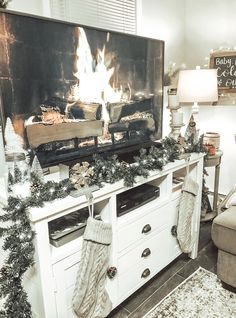 Tv stand Christmas decor stockings garland twinkle lights - TV Stands - Ideas of TV Stands
