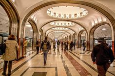 Moscow Metro station, which features mosaic scenes of sports found in the top of each illuminated dome