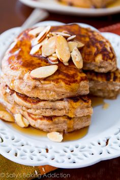 Healthy Whole Wheat Pancakes - that actually taste good. Made with Greek yogurt, oats, whole wheat flour, and not much else. sallysbakingaddiction.com