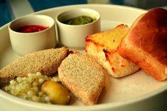 Aloo Chop  Potato cutlets served on a bun with assorted chutneys and saboodana poha.