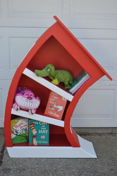 4 ft. Cat In The Hat Bookcase / Dr Seuss Bookshelf / Whimsical Bookcase / Alice in Wonderland Furniture / Dr Seuss Bookcase by InkedWoodworking on Etsy https://www.etsy.com/uk/listing/263461369/4-ft-cat-in-the-hat-bookcase-dr-seuss
