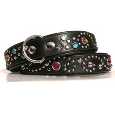 Custom made in the USA leather dog collar. The Stargazer is always one of a kind! wide base collar top layer Signature swirl design Tons of accent studs Your choice of jewel colors Available in Handmade Dog Collars, Jewel Colors, Bling, Leather Dog Collars, Swirl Design, Collar And Leash, Custom Leather, Dog Supplies, Pet Accessories