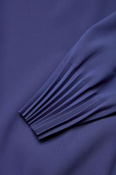 Pleated cuff and hem top in Blue