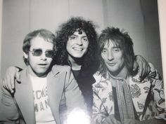 Elton John, Marc Bolan, and Rod Stewart photographed by Harry Goodwin, 1970s.