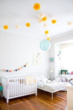Martina and Lola's Sweet Shared Space  Nursery Tour - a white crib and small white metal bed create a cozy shared kids bedroom