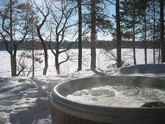 Hot tub in winter on the lake... yes please!