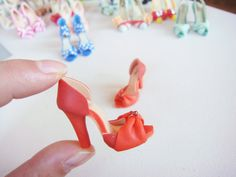 http://www.etsy.com/shop/YinyingO?section_id=12817346  Miniature High Heel Shoes - Handmade from Polymer Clay.