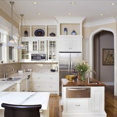 paint soffits same color as cabinets to make them look taller. Love ...