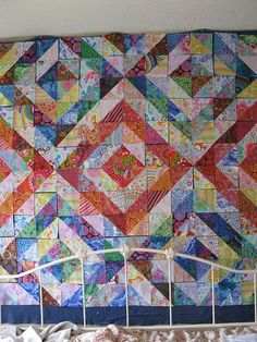 Color gets the credit, value does the work. Half-square triangle quilt