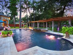 Beautiful setting and stone work surrounding this swimming pool in this fantastic luxury home in Hunters Creek Village, United States