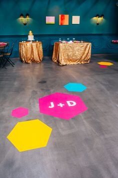 geometric floor decals - photo by Christine Farah Photography http://ruffledblog.com/colorful-la-wedding-at-the-fig-house #weddingideas #geo