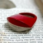Impossible rings made from books - hundreds of sheets of paper laminated together, and finished to a high gloss.  Gorgeous and so original - by littlefly - Jeremy May.