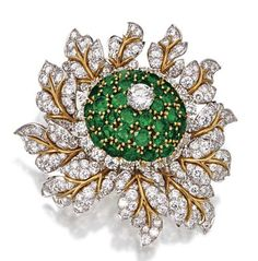 EMERALD AND DIAMOND FLOWER BROOCH, VAN CLEEF & ARPELS, NEW YORK, CIRCA 1965.  The flowerhead center of domed form set with numerous round emeralds and 1 round diamond weighing approximately .85 carat, the petals set with approximately 226 round diamonds weighing approximately 12.75 carats, mounted in platinum and 18 karat gold, signed Van Cleef  & Arpels, N.Y.