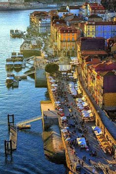 "Porto - The alluring district of Ribeira is made up of medieval streets and seedy alleyways. It is a crumbling but fascinating place, ending at a riverfront square (""Praça da Ribeira""). Wth photogenic traditional boats floating at the quayside overlooked by colorful ancient houses, this is the most picturesque spot in the city and the place everyone loves -- UNESCO did too, and declared it a World Heritage Site."