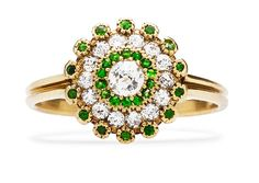 Holden is a whimsical Victorian era vintage ring featuring diamonds and bright green garnets in a pretty 18k yellow gold flower design. One of our personal favorites! TrumpetandHorn.com | $4,100