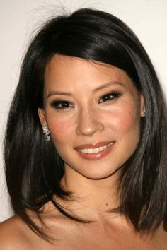 We love #LucyLiu's luscious strands. The long layers are universally flattering—try them at your next salon appointment! #hair #beauty #inspiration