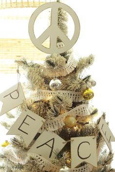 DIY Peace Sign Christmas Tree Topper and gorgeous eclectic neutral tree in white, gold, and silver.