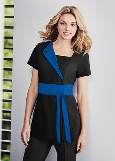 Stylish and sophisticated black beauty tunic with cobalt blue contrast lapel and decorative sash.  Shop at www.simonjersey.com for beauty tunics, beautician uniforms, beauty therapist's tunic, salon uniforms, spa uniforms, hairdressing tunics.  Perfect for many work places including beauty salons, spas, hairdressing salons, cosmetic surgeries, dog grooming salons, hotels, boutique hotels and more.
