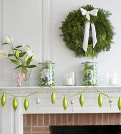 Christmas mantle, cute photo vases with green ornaments ;)