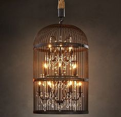 (Paul Michael has smilar birdcage without lights.) Great diy Restoration Hardware knock off lamp. Old birdcage, chandelier type lamp, some rope and lamp gems, some bronze paint. Birdcage Light, Birdcage Chandelier, Antler Chandelier, Cage Deco, Chandelier Bougie, Bottle Chandelier, Foyer Chandelier, Diy Luz, Chandeliers