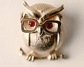 So cute! OWL WITH GLASSES JEWELRY PIN ck.. Jeremy Renner with glasses, an owl pin with glasses, toss up!  LOL