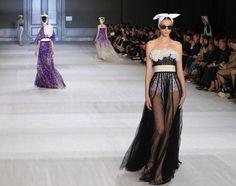 Models wear creations by Italian-born fashion designer Giambattista Valli