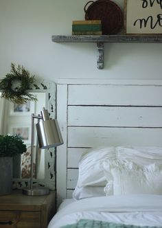 Our DIY Wall Shelf Above Our Bed, Under 15 bucks and  takes minute to make! Gorgeous Farmhouse Master Bedroom WhiteonWHiteonWhite www.theruggedrooster.com
