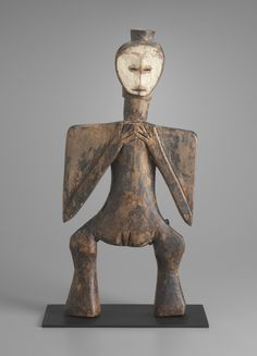 Female Figure  late 19th to early 20th century Wood and pigment Object: 49.3 x 22.9 x 6.7 cm (19 7/16 x 9 x 2 5/8 in.) Charles B. Benenson, B.A. 1933, Collection 2006.51.58 Geography:  Made in Central Africa, Congo (Kinshasa) Culture:  Lega