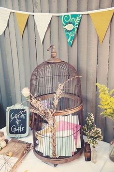 Amy says she has an old bird cage I could use... and card table