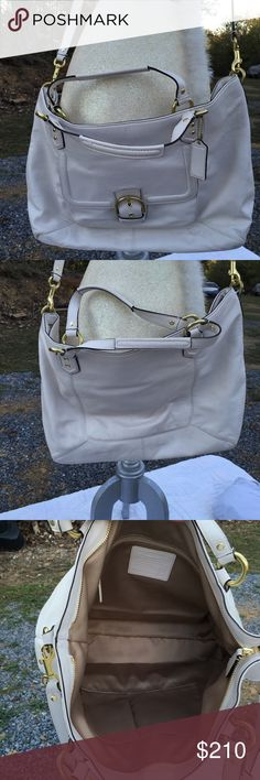 Coach Large All Leather Satchel White and gold large bag. Has shoulder handles and cross body strap. Inside beautiful gold lining with zippered pocket and slip pockets. Will carry anything you can put into a bag. Love this large beautiful bag. Coach Bags Satchels