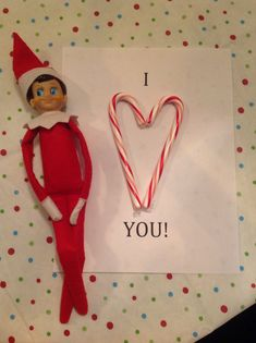 Love note from the Elf w/ a heart made from 2 candy canes put together.
