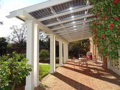 Energy saving pergola keeps your house cool while generating electricity.