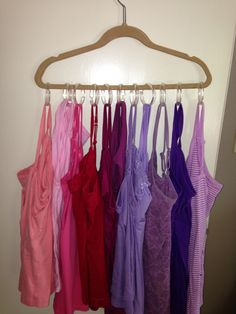 Hang Tank tops on a hanger with inexpensive shower curtain hooks.