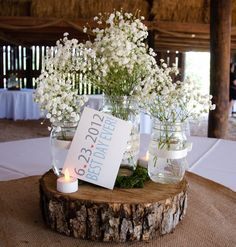 mason jar centerpieces | Our centerpieces were made from burlap squares, mason jars with ribbon ...
