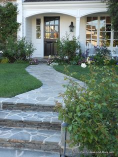 Gorgeous curved natural stone #walkway and beautiful landscaping make this home a beauty! Shared on Front-Porch-Ideas-and-More.com #walkwayideas #porchlandscaping