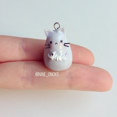 Adorable kitty with fish bone made with polymer clay