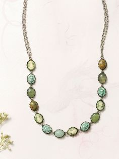 Necklace of 10x8 mm genuine stones of epidote, new jade, and green adventurine, with 10x8 green cameos, and 10x8 green resin oval rose
