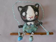 Swinging cat  spun cotton ornament by papermoongallery on Etsy, $29.00