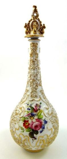 A 19th century French porcelain perfume bottle and stopper by Jacob Petit; Rococo; To cool the throat and decolletage