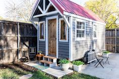 A farmhouse style tiny house from Timbercraft Tiny Homes. The 352 sq ft home is built on a gooseneck trailer and features flawless craftsmanship throughout.