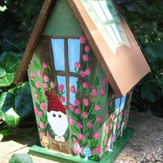 Welcome to The Paint Brushed Boutique  Item Description: This light-weight, hand painted birdhouse is designed to resemble a quaint cottage.