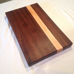 Handcrafted from only American Walnut and Hard Maple, this board will be a mainstay in your kitchen for years to come. I use only FDA approved