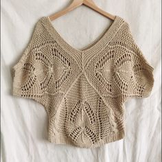 Tan crochet sweater top Tan colored short sleeve crochet sweater top. V neck and v back. Slightly oversized and can be worn off the shoulders. So cute and was always one of my favorites. Size medium. Forever 21 Forever 21 Tops