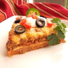 Burrito Pie_ Ground beef, refried beans and tomatoes are combined with chiles and taco sauce, then layered in a casserole with tortillas and cheese, and baked. Spicy Recipes, Mexican Food Recipes, Beef Recipes, Dinner Recipes, Cooking Recipes, Dinner Ideas, Yummy Recipes, Top Recipes, Cheese Recipes