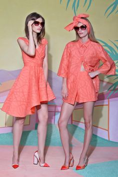 Christian Siriano Resort 2016 - the coral dress on the left - I love the shape of the hem and the way it's gathered in front