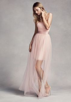 The Bridesmaid Dress With An Illusion Overskirt by Vera Wang from David's Bridal This classy tulle dress would be an ideal match for a garden wedding! It features a long sheer overlay and a flattering satin belt. What's not to love? Cost: $199.95