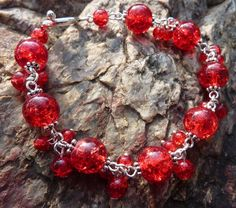 Bracelet made from red crackled glass beads and silver eyepins. Crackle Glass, Bracelet Making, Beadwork, Glass Beads, Pendants, Bracelets, Earrings, Silver, Red